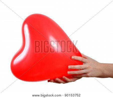 Balloon in the shape heart in hands