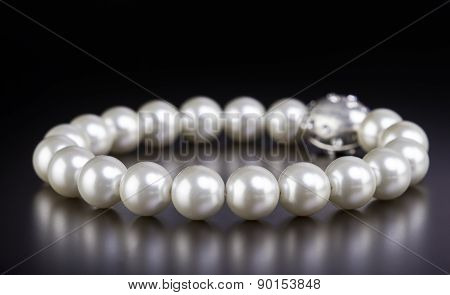 White Pearls Necklace on Black