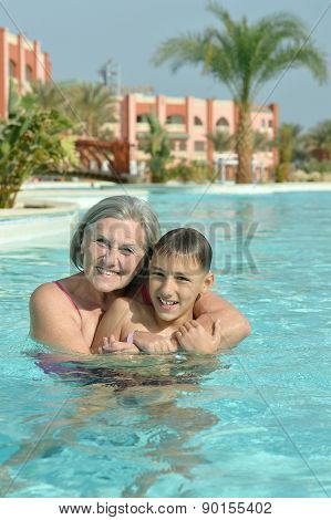 Grandma and grandson in pool