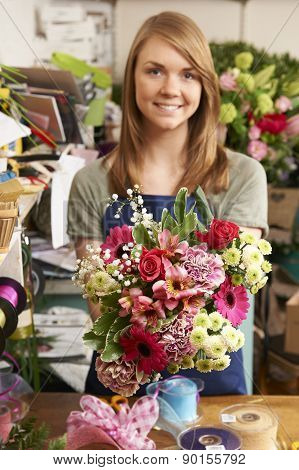Florist Working On Bouquet In Shop