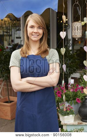 Portrait Of Female Owner Standing Outside Florist
