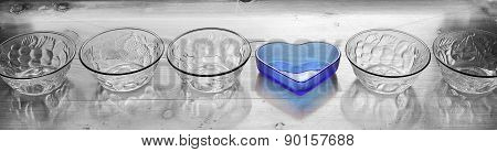Kitchen Dishes With One Standing Out Of Crowd