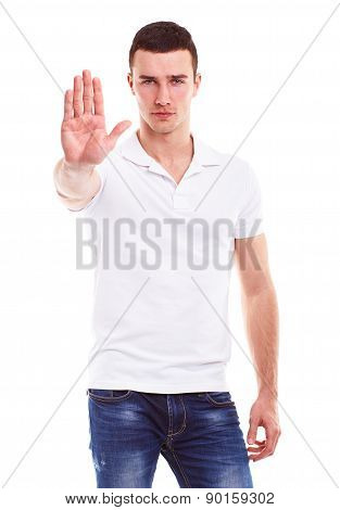 Young Man Makes A Gesture Stop, On A White Background