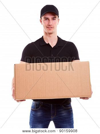 Smiling Delivery Man Holding A Cardboard Box On A White Background