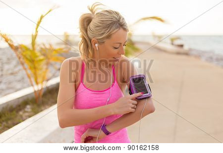 Woman using sports tracking mobile app on her smartphone