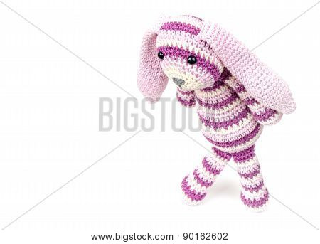 Sad Knitted Rabbit Toy Goes Over White Background