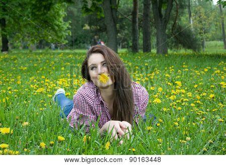 Beautiful Woman On The Grass