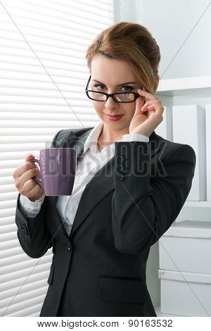 Playful Young Businesswoman Taking Off Her Glasses