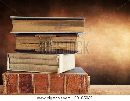 Heap of books with brown background