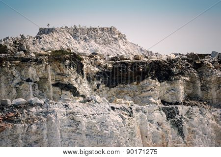 Steep Rocky Cliffs In An Open Pit Marble Mine