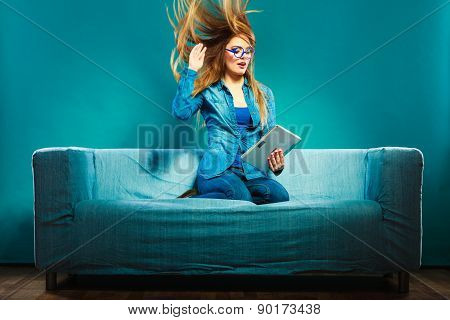 Girl Hair Blowing With Tablet On Couch