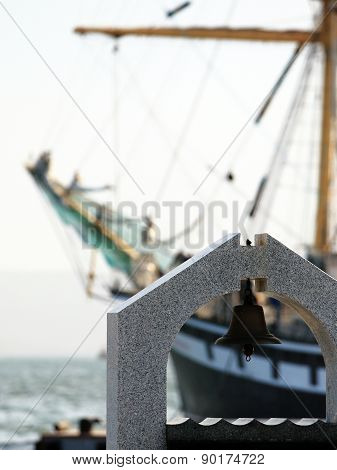 Rynda on the background of a sailboat