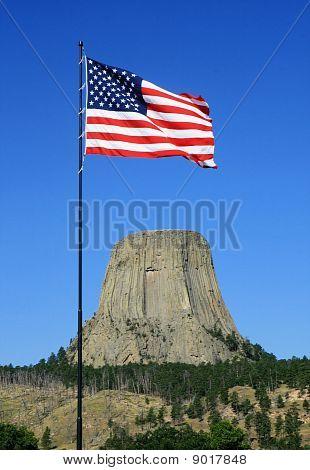 Us Flag At Devils Tower