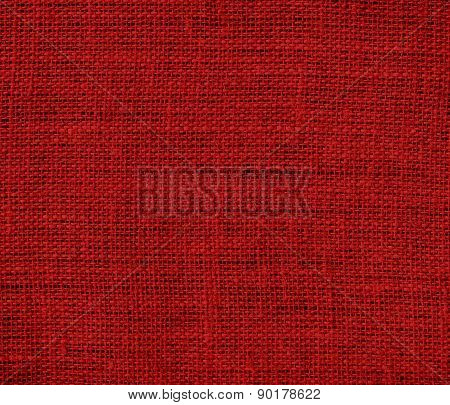 Crimson red color burlap texture background