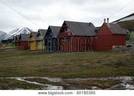 Houses in  Spitsbergen, Svalbard, Norwaw on a cloudy day.