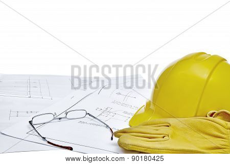 Blueprints With Hardhat, Workgloves And Reading Glasses