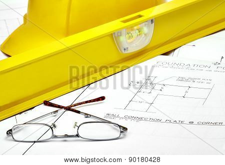 Reading Glasses On Blueprints With Level And Hardhat