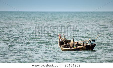 Single boat floating on a sea