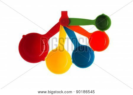 Color Plastic Dosing Spoons Isolated On A White Background