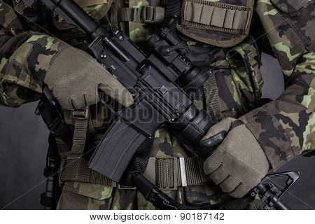 Detail Of A Soldier Holding Modern Weapon M4