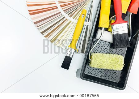 Paint Rollers And Brushes In Tray With Color Guide