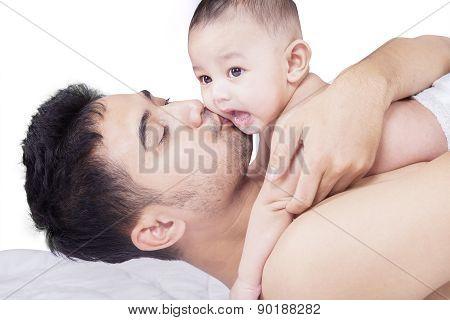 Dad Kiss His Little Son