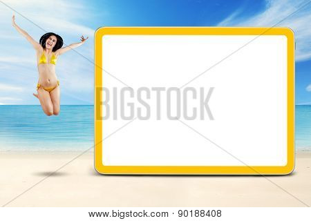 Excited Model Leaps At Shore Near The Board