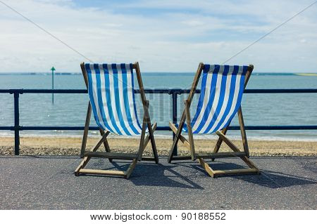 Two Deck Chairs By The Seaside