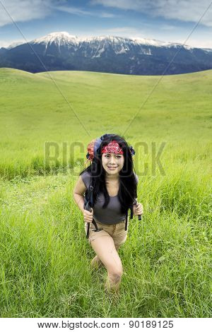 Female Hiker Exploring The Mountain