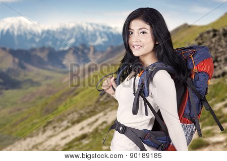 Female Hiker On The Mountainside