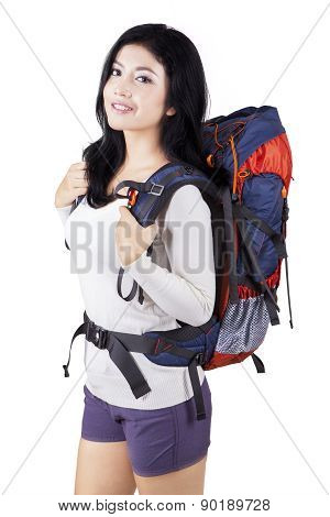 Female Hiker With Rucksack In Studio