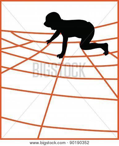 Boy Climbing A Jungle Gym Net