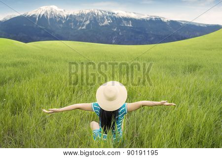 Happy Woman Stretch Her Arms At Field
