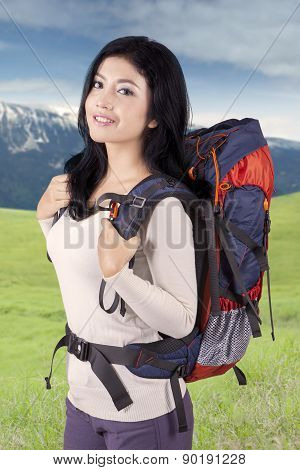 Happy Woman With Rucksack Outdoors