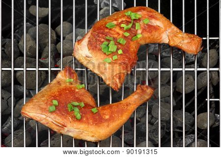 Two Bbq Roast Chicken Quarters On The Hot Charcoal Grill