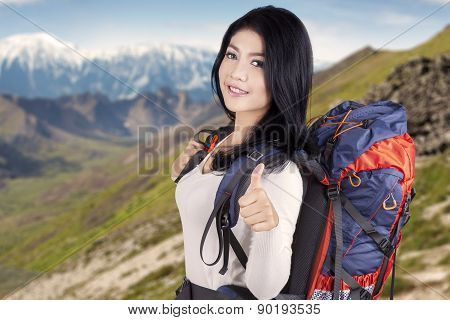 Pretty Backpacker Showing Thumb Up