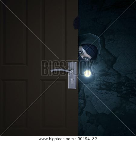 Robber Sneaking Through Door