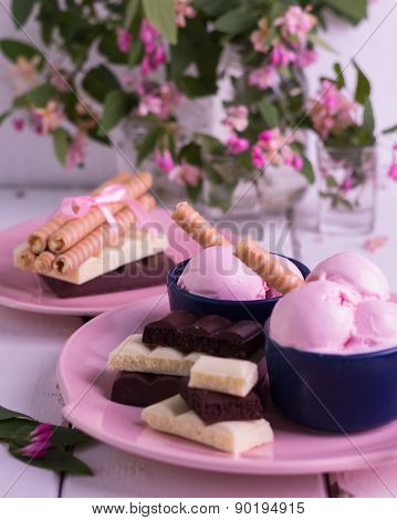 Strawberry Ice Cream Scoops With Wafer Rolls.