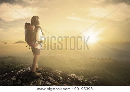 Woman Enjoying Valley View From Mountainside