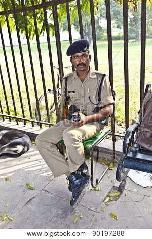 policeman pays attention in the Red Fort
