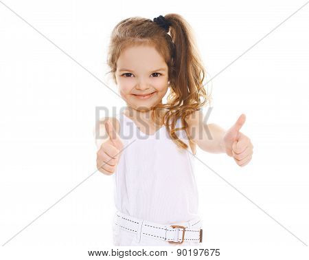 Portrait Of Cheerful Little Girl Showing Thumbs Up