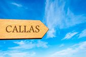 picture of calla  - Wooden arrow sign pointing destination CALLAS FRANCE against clear blue sky with copy space available - JPG