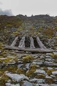 foto of gravity  - Only remaining wood bridge of gravity incline Cwm Penmachno Slate Quarry Snowdonia Wales United Kingdom - JPG