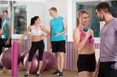 picture of flirt  - Attractive woman flirting with personal instructor - JPG