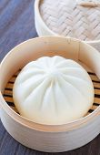 stock photo of steam  - Traditional chinese cuisines steamed bun in asian style bamboo basket - JPG