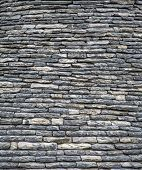 pic of stone house  - Close view of the stones of the roof of a house in Alberobello - JPG