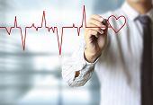 picture of heartbeat  - man drawing heart and chart heartbeat - JPG