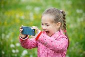 Little Girl Photographing With Her Smartphone poster