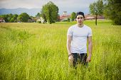 picture of grassland  - Handsome fit young man at countryside - JPG