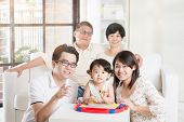 stock photo of multi-generation  - Portrait Of Asian Multi Generation Family - JPG